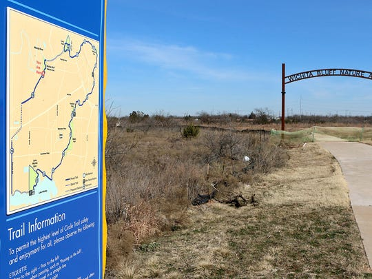 Construction boundaries are set up near the Wichita Bluff Nature Area as crews work to complete one of three gaps left in what will be the 24-mile Circle Trail.