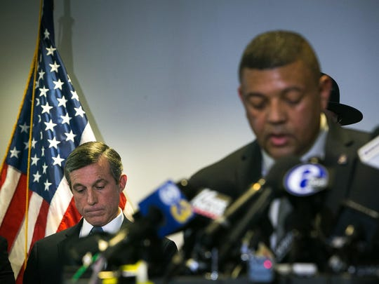 Delaware Gov. John Carney, left, listens to Perry Phelps, commissioner of the state Department of Correction, during a news conference held at Troop 2 in Bear, Del., on the loss of one of the prison guards at James T. Vaughn Correctional Center on Thursday, Feb. 2, 2017, during the hostage situation.
