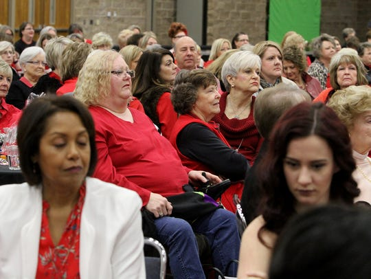 Woman listen to former first lady Laura Bush speak