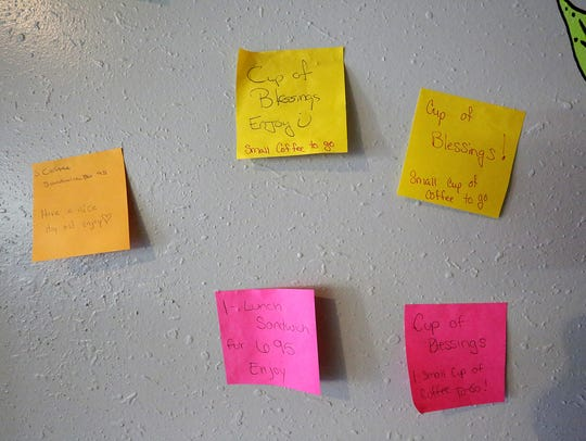 Post it notes with pre-paid menu items stick on the