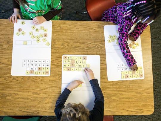 Students inside a kindergarten class.