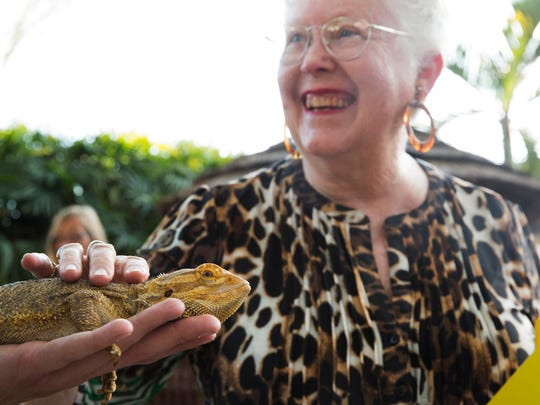 Nancy Webster, of Naples, touches a bearded dragon during ZOObilee on March 14, 2015.