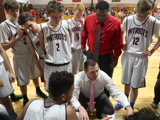 Liberty Christian Head Coach Todd Franklin talks to his team during the first half of Tuesday night's playoff game against Greenville.