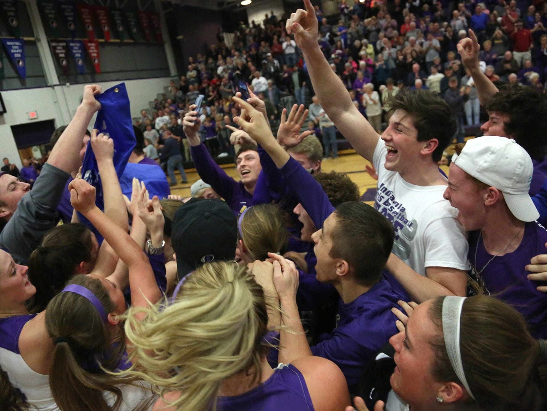 Indianola fans celebrate with the team. Indianola beat Sioux City East 71-36 in a Class 5A regional final Feb. 21 in Indianola.