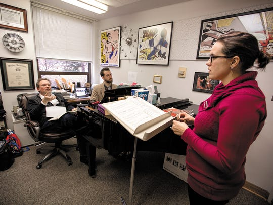 """Faculty member Jon Truitt (left) instructs doctoral student Kelci Kosin (right) during their rehearsals of """"Carmina Burana,"""" as graduate student Michael Rigney accompanies them on piano. Truitt has been Kosin's voice teacher for almost 10 years and will perform the piece with her when the two take the stage at the Palladium."""