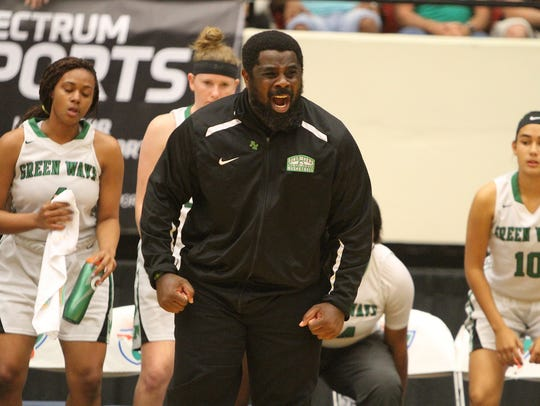 Ft. Myers head coach Chad Terrell yells plays from