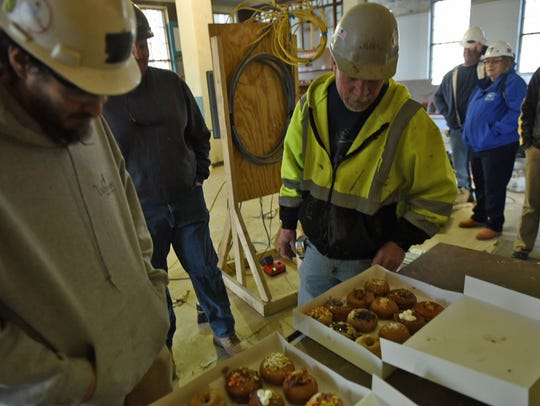 Construction workers choose doughnuts on Tuesday at