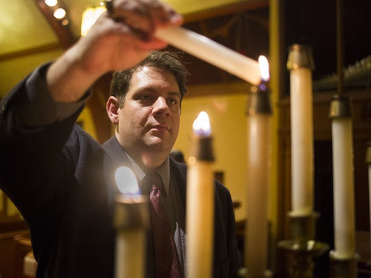 The Rev. Christopher Rodkey lights candles in preparation for the service. St. Paul's United Church of Christ in Dallastown hosted members of the Islamic Community Center of Lancaster for an Ash Wednesday dinner and service, Wednesday, March 1, 2017.