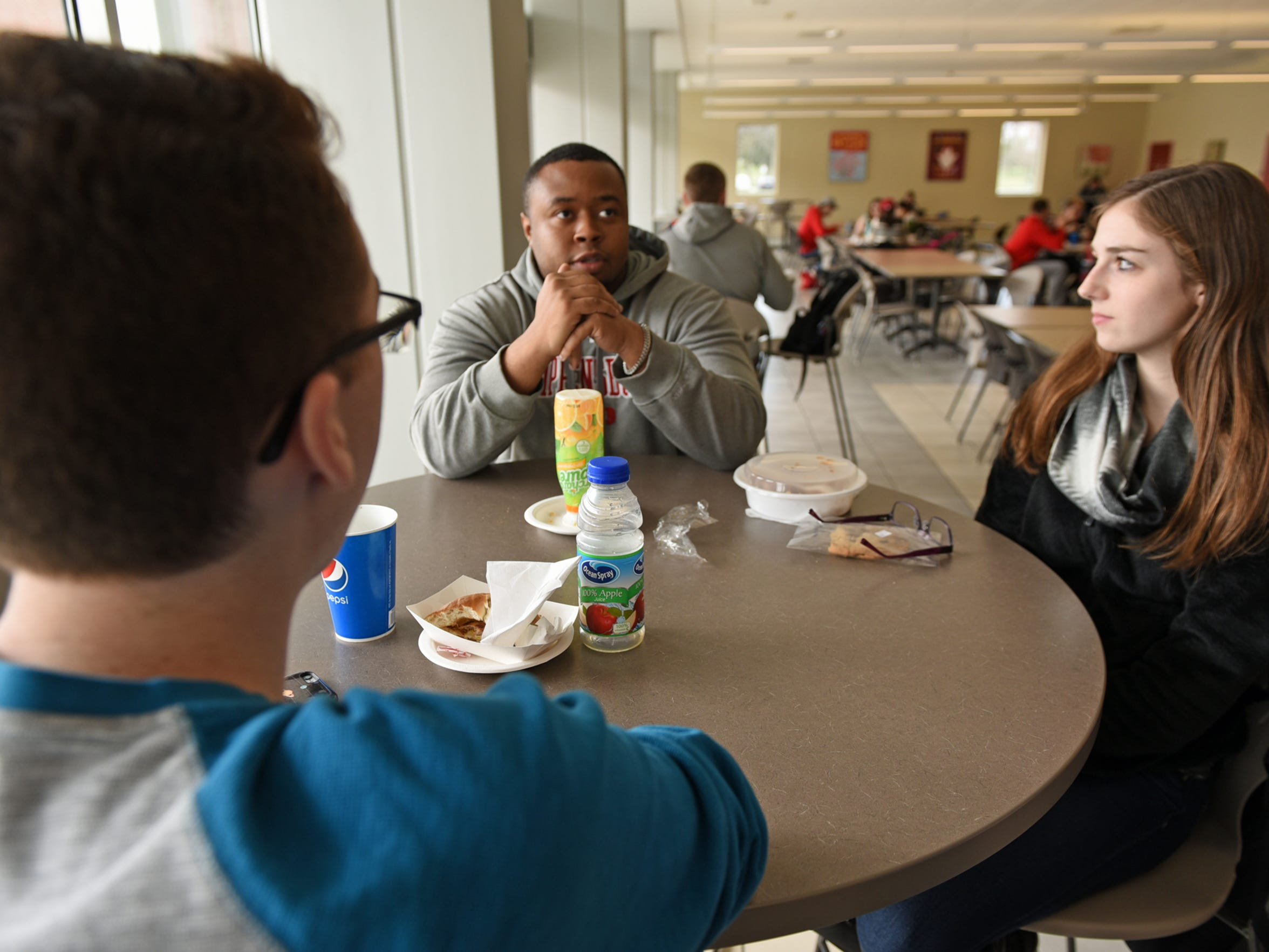 Shippensburg University senior Miles Dean talks said that he does not plan to carry college debt for as long as some students. Dean and students Lane Yutzy and Brooke Poe, right, talked to reporters Thursday, March 2, 2017 on the college campus.