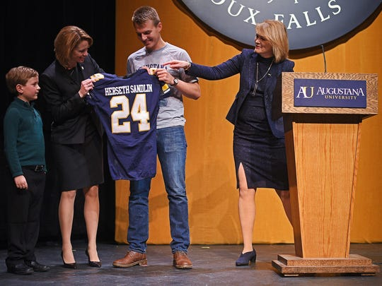 Augustana president Stephanie Herseth Sandlin receives some Augie gear during her introduction as the school's new president in 2017.