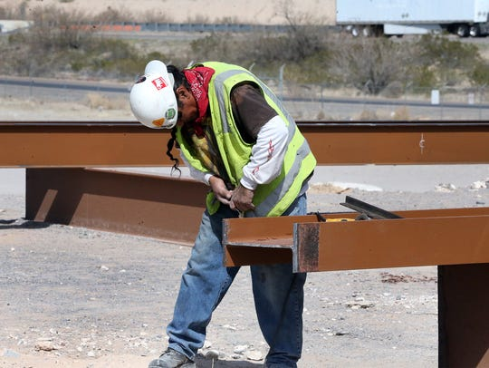 Rudy Carrillo works on a section of a new attraction