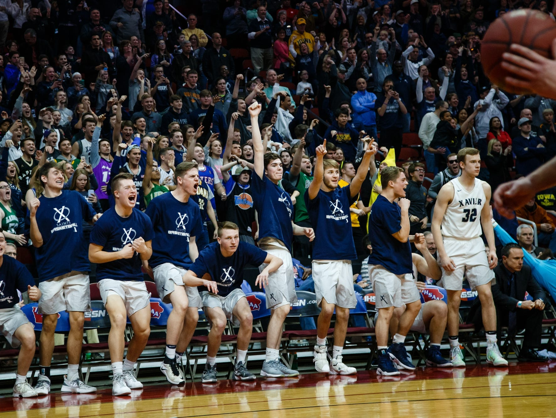 The Cedar Rapids, Xavier bench erupts as time runs out and they defeat Sergeant Bluff-Luton during their 3A state basketball championship game on Saturday, March 11, 2017, in Des Moines. Cedar Rapids, Xavier would go on to win 54-49.