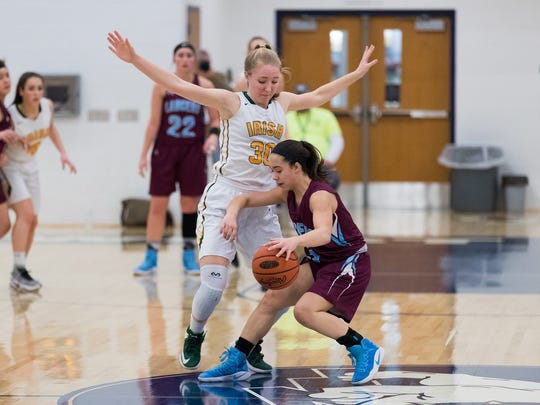 Loyalsock's Juliana Cruz (5) dribbles the ball while guarded by York Catholic's Katy Rader (30) during the first-round matchup of the PIAA Class 3A between York Catholic and Loyalsock on Saturday, March 11, 2017 at West York High School.