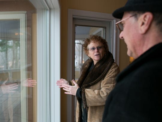 Karen Menachof, a licensed real estate salesperson with Nothnagle Realtors, shows a home overlooking Irondequoit Bay on Monday, March 13, 2017.
