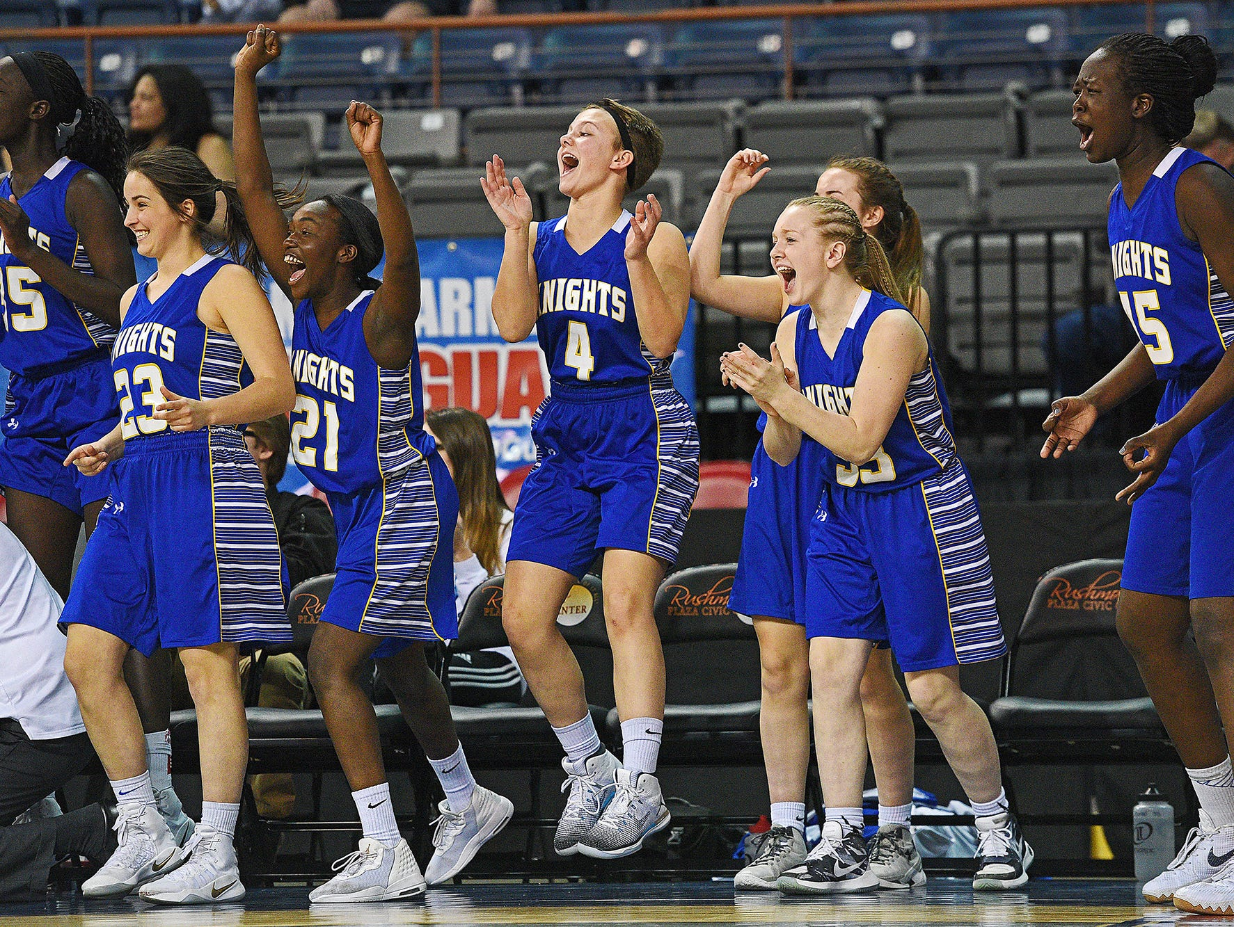 O'Gorman players react from the bench after a teammate scored during a 2017 SDHSAA Class AA State Girls Basketball quarterfinal game against Roosevelt Thursday, March 16, 2017, at Rushmore Plaza Civic Center in Rapid City. O'Gorman beat Roosevelt 37-33.