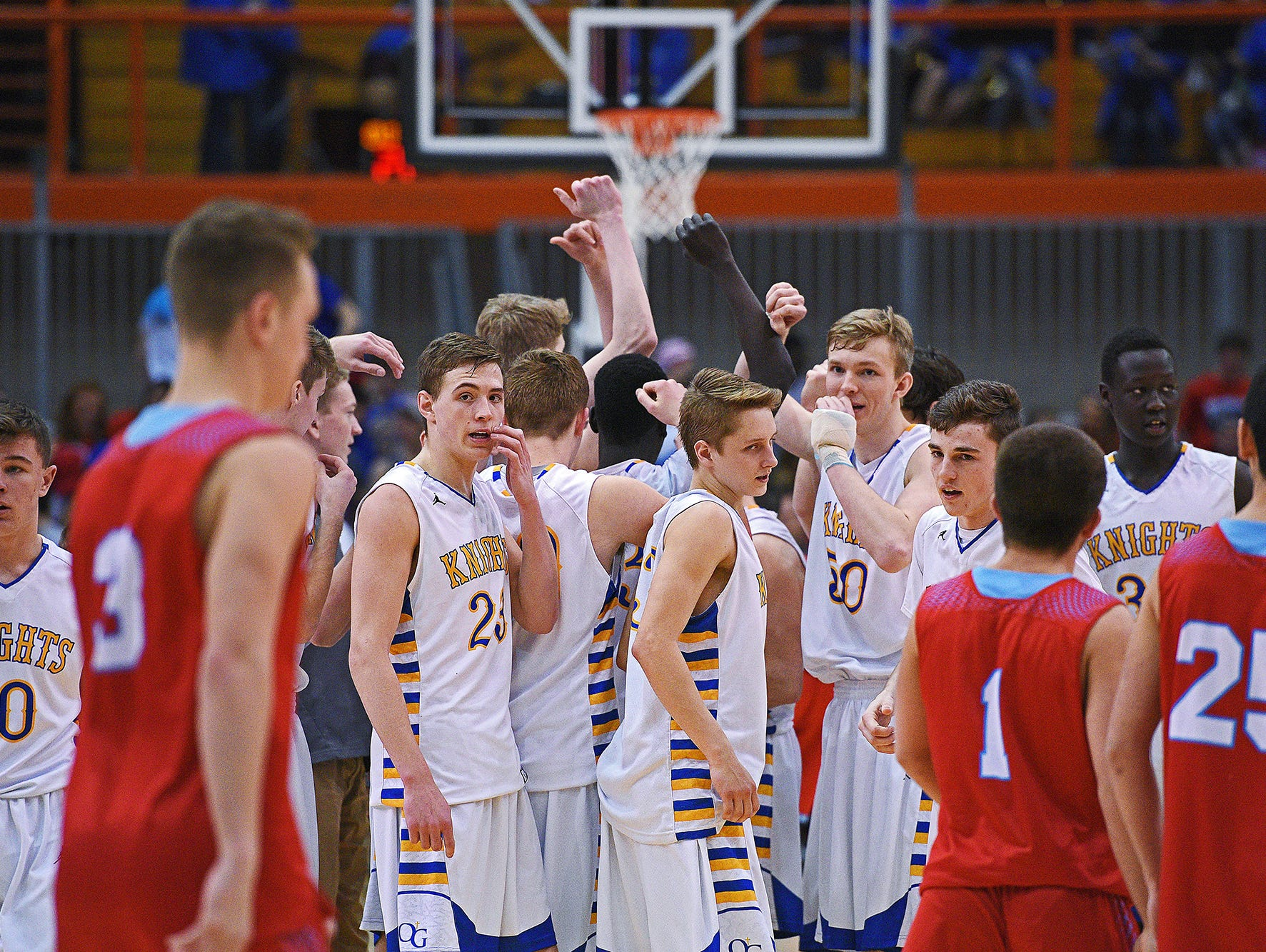 O'Gorman players huddle after their 64-44 win over Lincoln in a 2017 SDHSAA Class AA State Boys Basketball semifinal game Friday, March 17, 2017, at Rushmore Plaza Civic Center in Rapid City.