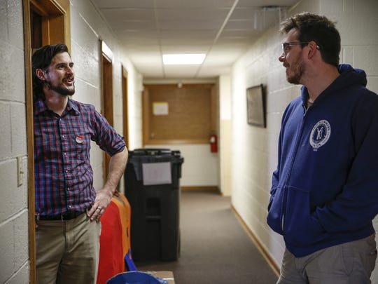 Stuart Mora, left, president of the Indiana chapter of Unite Here Local 23, speaks with Paul Nappier, organizer for Service Employees International Local 1, shortly after House Speaker Paul Ryan pulled the American Health Care Act from the floor before a scheduled vote on Friday, March 24, 2017.