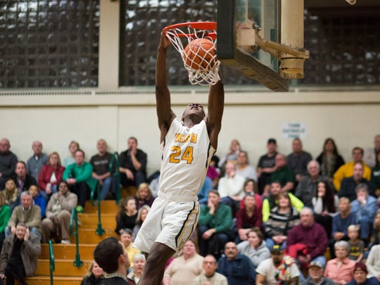 York Catholic's Melik Martin dunks the ball against Delone Catholic.