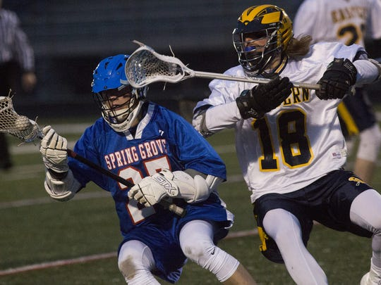 Cole Witman, right, defends Spring Grove's Tanner Bolton during Thursday's YAIAA lacrosse game.
