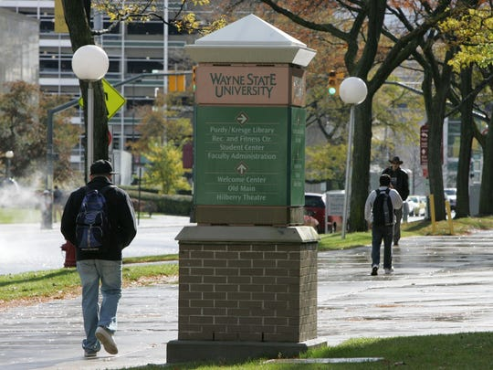 Budget cuts at Michigan's public universities are disproportionately hurting black students by making it more difficult for them to attend college, a new report argues