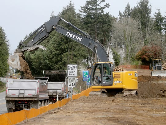A new segment of the Sound to Olympics Trail, along Highway 305 on Bainbridge Island, necessitated clearing of trees. Some neighbors aren't happy with the work.