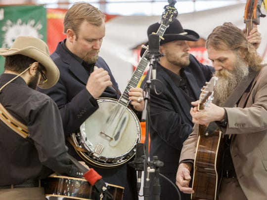 Charlie Formaro (from left), Andrew Hoiberg, Jerry Hoehle and Jeff Blanchard play with Mr. Baber's Neighbors Saturday, Feb. 9, 2013, during the 6th annual Blue Ribbon Bacon Festival at the Iowa State Fairgrounds in Des Moines.