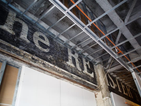 "The old ""Register and Tribune"" sign painted onto the side of the building can be seen in what is being turned into a loft space at the R and T lofts on Thursday, April 13, 2017, in Des Moines."