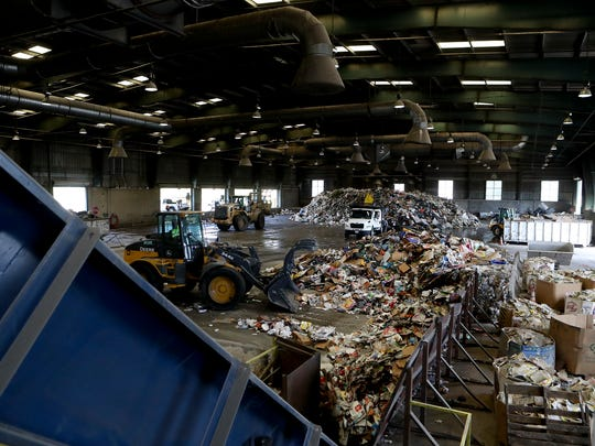 In this April 2017 file photo, Redding waste management crews work inside the city's material recovery facility.