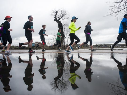 Runners dodge puddles on River's Edge Trail during last year's Ice Breaker Road Race.
