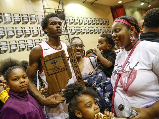 North Central Panthers Kris Wilkes (31) poses for a photo with a trophy after the Panthers defeated the Lawrence North Wildcats in their IHSAA 4A sectional final basketball game at North Central High School on Saturday, March 4, 2017.
