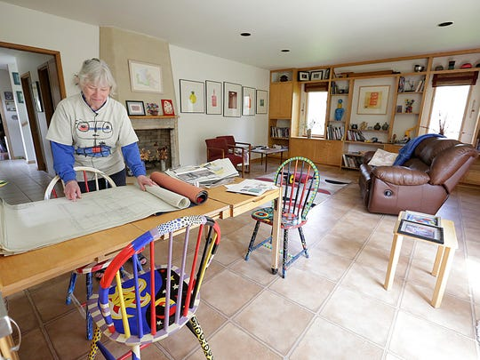 Roxine McQuitty looks at the designs for the house she owns in Fond du Lac. Fond du Lac commercial architect Sylvester Stepnoski designed the house in 1958. Stepnoski designed many commercial buildings in Fond du Lac and incorporated the commercial look into his house. Wednesday May 3, 2017. Doug Raflik/USA TODAY NETWORK-Wisconsin