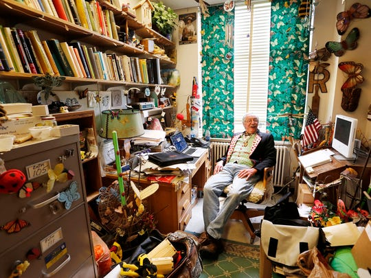 Books, cabinets and insect memorabilia fill the office