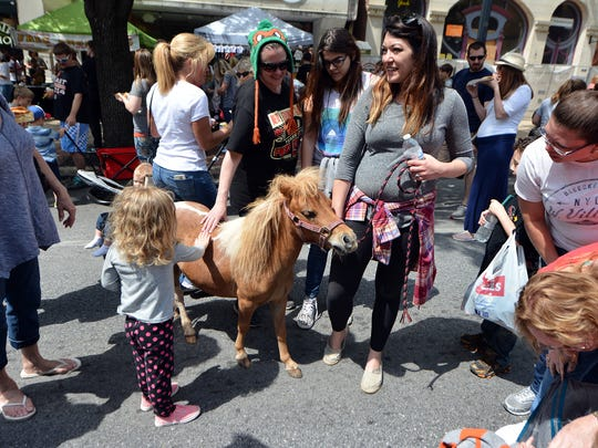 Chasta Strouse of Dover and her miniature horse Liliana Luce visit the 42nd Annual Olde York Street Fair, Sunday, May 14, 2017.  John A. Pavoncello photo