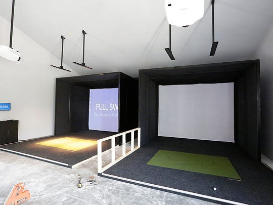 Two golf simulators are in place at Donny Du's, which