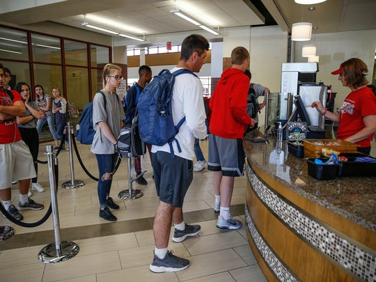 Fishers High School students wait in line to purchase snacks and beverages from the cafe in between classes.