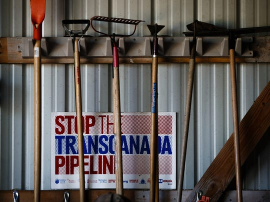 Signs line the wall of at Art Tanderup's shed where people shell Sacred Ponca Corn to plant on Sunday, May 21, 2017, in Neligh.