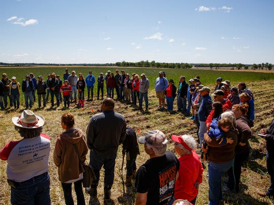 People listen to instructions before planting Sacred Ponca Corn by hand on Art Tanderup's land where the Keystone XL pipeline would cross it on Sunday, May 21, 2017, in Neligh. The ancient corn variety was thought to be lost when the Ponca tribe was driven out of Nebraska, but some seeds were found and have been planted here for the past four years in an effort to block the pipeline and reestablish the variety.