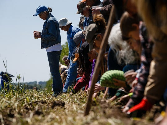 People plant Sacred Ponca Corn on Art Tanderup's land where the Keystone XL pipeline would cross it on Sunday, May 21, 2017, in Neligh. The ancient corn variety was thought to be lost when the Ponca tribe was driven out of Nebraska, but some seeds were found and have been planted here for the past four years in an effort to block the pipeline and reestablish the variety.