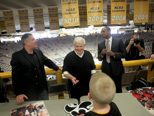 Former Iowa assistant coach Bruce Pearl, left, former Iowa men's basketball head coach Tom Davis, and former Iowa guard and three time NBA champion B.J. Armstrong signed autographs before Iowa's contest against Penn State on Saturday, February 4, 2012.