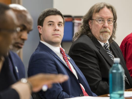 John Rago listens to a speaker during a meeting with city officials and community leaders on recommendations from a CDC report on violence in the city at the Achievement Center in Wilmington.