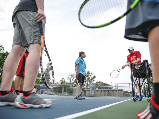 """Steve Mackell, right, program director for the National Junior Tennis League (NJTL) of Indianapolis, says Rogelio could play college tennis — """"We're talking high-level Division I, if he wants it."""""""