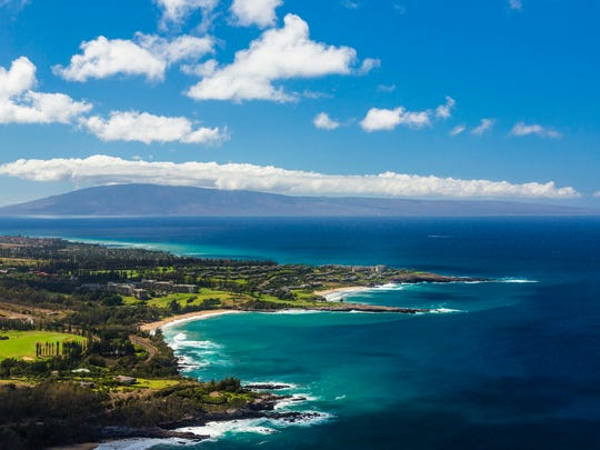 This undated photo provided by the Hawaii Tourism Authority shows a view of the Kapalua coastline in Maui, Hawaii. Kapalua Bay Beach is No. 2 on the list of best beaches for the summer of 2017 compiled by Stephen Leatherman, also known as Dr. Beach, a professor at Florida International University. (Tor Johnson/Hawaii Tourism Authority via AP)