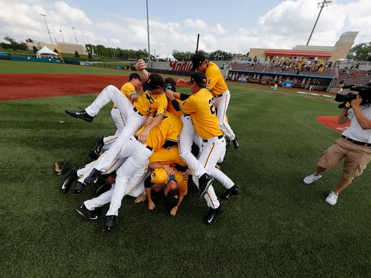 Iowa's baseball team dogpiles after winning the Big Ten Tournament Sunday in Bloomington, Ind.