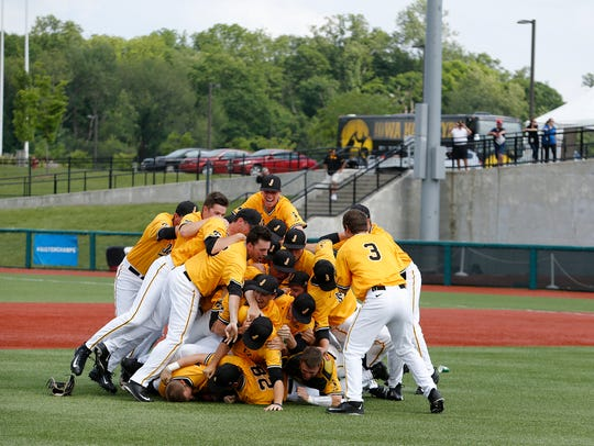 Iowa players celebrate postgame after winning the Big