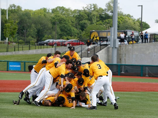Iowa players celebrate postgame after winning the Big Ten Tournament Sunday in Bloomington, Ind.