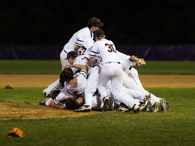 East Pennsboro players pile on top of Chris Horst (5)