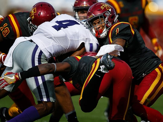 Kansas State's Dominique Heath is tackled by Iowa State's D'Andre Payne during their game on Saturday, Oct. 29, 2016, in Ames. Kansas State would go on to win 31-26.