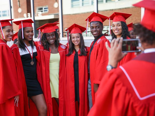 Third from left, Lynna Irby poses for a picture with her best friends, as they prepare to graduate from Pike High School at the Indiana Farmers Coliseum, Indianapolis, Thursday, June 1, 2017.