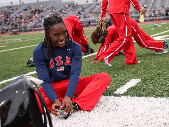 Pike High School runner Lynna Irby waits around between races during Marion County track and field championships, Tuesday, May 22, 2017.