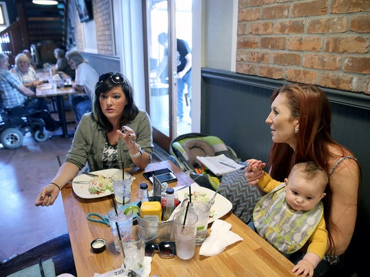 Erynn Bosch, left, Kim Smith, and her 9-month-old son Coltrane have lunch at Brick House in Port Orchard. The new owners of the former MoonDogs Too said they were aiming for a more family-friendly atmosphere.